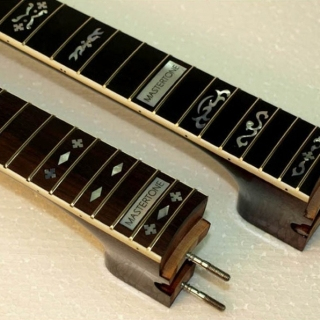 Old style inlay pattern on new necks